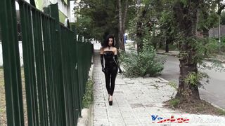A highly uber-sexy gothic chick heads for a walk wearing latex. Thumb