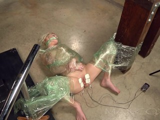 Zoey Paige is packaged in Cellophane, her Fuckbox Unveiled for Fetish Games Thumb