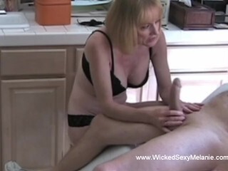 Blond Cougar Doing Some Additional Hand Job for Husband Thumb